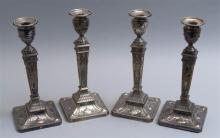 ASSEMBLED SET OF FOUR BARKER ELLIS NEOCLASSICAL-STYLE STERLING SILVER AND SILVER PLATED CANDLESTICKS Each with removable bobèche wit...