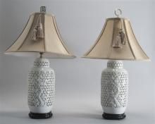 PAIR OF CHINESE BLANC DE CHINE PORCELAIN LAMPS In the form of ginger jars with openwork and cherry tree design. Gold silk shades wit...