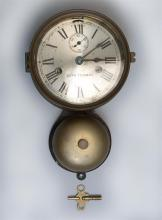 SETH THOMAS SHIP'S BELL CLOCK Brass case. Retains partial paper label on back panel. Height 11.25