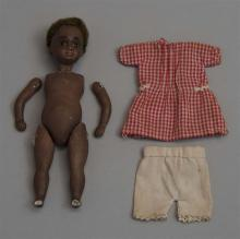 GERMAN BISQUE BLACK DOLL With brown glass eyes. Unstrung. Height approx. 5