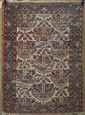 ORIENTAL RUG: HAMADAN With a crown design on a cream field.