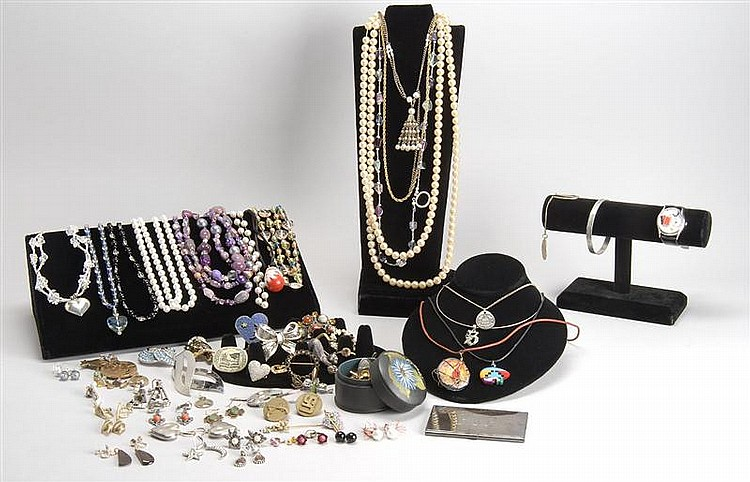 LARGE LOT OF COSTUME JEWELRY by various makers. Includes necklaces, brooches, earrings, etc.