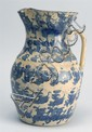 ANTIQUE SPATTERWARE HANDLED POTTERY PITCHER with blue sponge decoration on a yellow ground. Height 9½