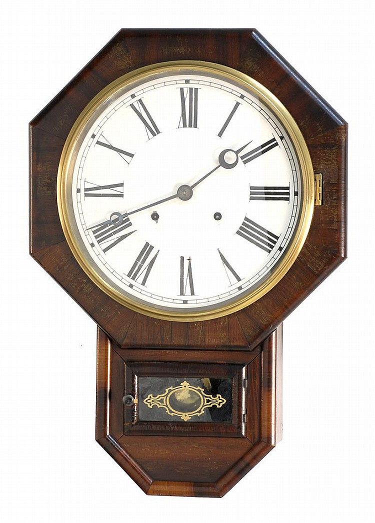 WATERBURY WALL REGULATOR CLOCK in mahogany veneer case. Height 23½