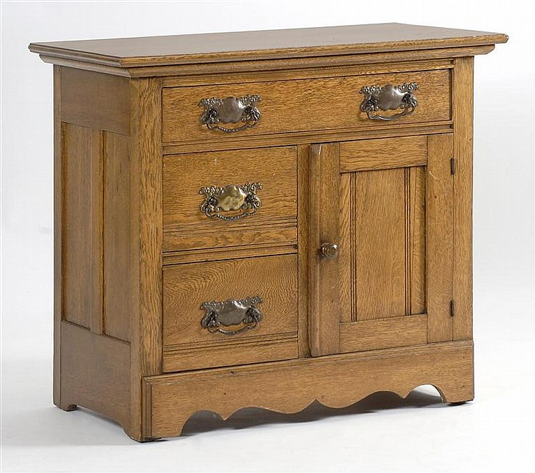 LATE 19TH/EARLY 20TH CENTURY OAK COMMODE with full-width drawer above two half-drawers and one cupboard door. Height 28½