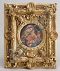 CIRCULAR PAINTED PORCELAIN PLAQUE in original gilt frame. Depicts a woman with two children. Fleur-de-lis above an illegible word on...