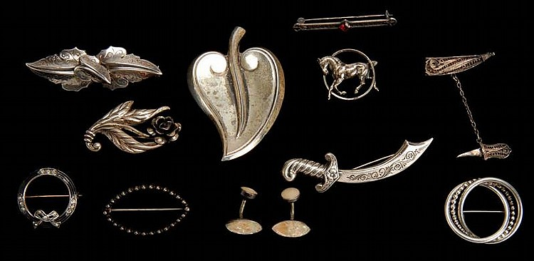 TWELVE PIECES OF ASSORTED STERLING SILVER JEWELRY. Including ten pins and a pair of shirt buttons.