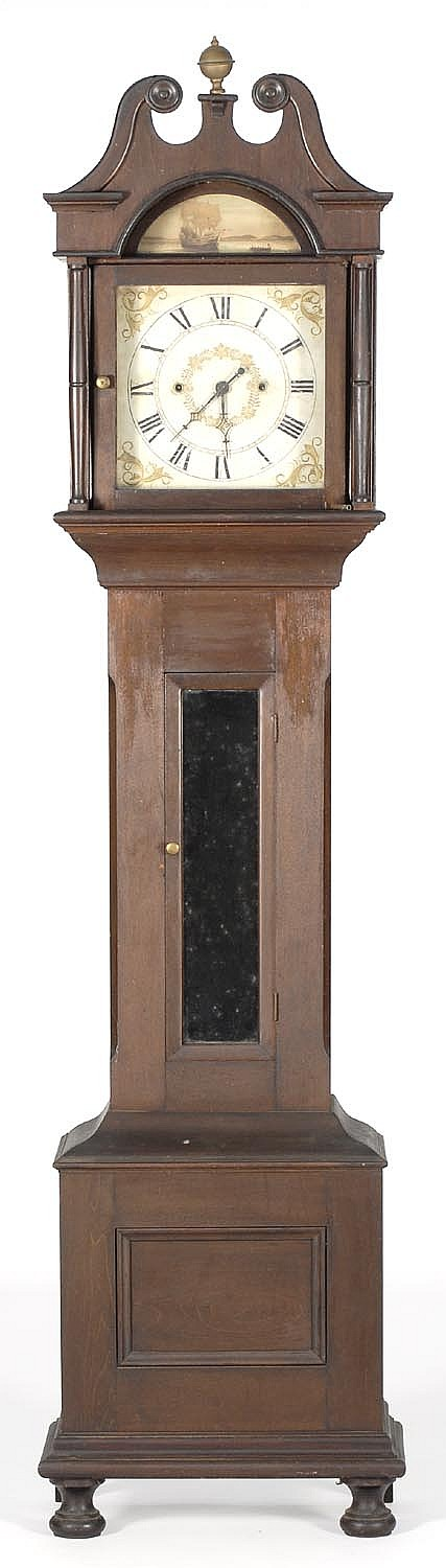 TALL-CASE CLOCK. Probably in cherry under a dark stain. Bonnet with broken-arch pediment. Central glass door. Turned bun feet. Heigh...