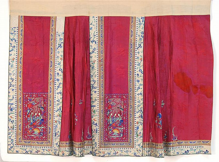 PLEATED SILK SKIRT With figural needlework design on a burgundy-red ground.