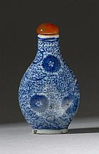 BLUE AND WHITE PORCELAIN SNUFF BOTTLE In pear shape with passionflower and vine design. Four-character Qianlong mark on base. Height...