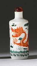 POLYCHROME PORCELAIN SNUFF BOTTLE In cylinder form with five-claw dragon design. Four-character Daoguang mark on base. Height 3