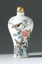 POLYCHROME PORCELAIN SNUFF BOTTLE In meiping form with bird and flower design. Four-character Guangxu mark on base. Height 3