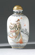 PORCELAIN SNUFF BOTTLE In elongated ovoid form with red, black, and gold design of a flute player. Four-character Qianlong mark on b...