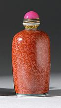 SGRAFFITO PORCELAIN SNUFF BOTTLE In cylinder form with rust-red leaf design. Four-character Guangxu mark on base. Height 2.7