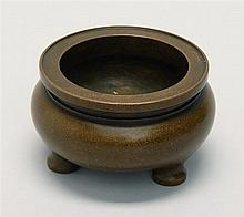 BRONZE TRI-FOOT CENSER In ovoid form with brown patina. Three-character mark on base. Diameter 3