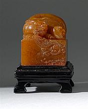TRANSLUCENT YELLOW STONE SEAL Possibly Tianhuang. In square form with dragon and coin finial. Six characters cut into base. Height 2...