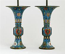 PAIR OF CLOISONNÉ ENAMEL TRUMPET VASES In passionflower design on a blue ground. Mounted as table lamps. Heights of vases 13.8