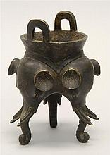 TRIPOD BRONZE CENSER With elephant's-head base and loop handles. Height 5.5