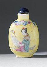 PORCELAIN SNUFF BOTTLE In elongated ovoid form with bird and figural design on a yellow ground. Height 2.3