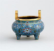 CLOISONNÉ ENAMEL CENSER In ovoid form with tripod base and loop handles. Body decorated with passionflowers and vines on a blue grou...