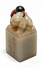 GRAY JADE SEAL In rectangular form with lion-form finial. Base cut with four characters. Height 2.7