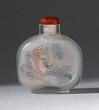 INTERIOR-PAINTED GLASS SNUFF BOTTLE In flattened ovoid form. With tiger design on one face; mandarin ducks on reverse. Height 2.5