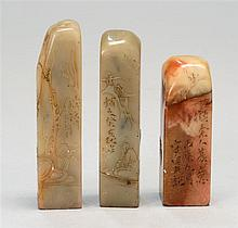 THREE SOAPSTONE SEALS All with landscape carving. Heights 2.3