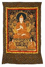 GOLD AND SILK NEEDLEWORK THANKA Depicting a seated lama with two acolytes. 41