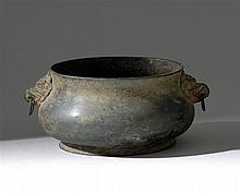 BRONZE CENSER In squat ovoid form with lion and loose ring handles. Six-character Xuande mark on base. Length 7.7