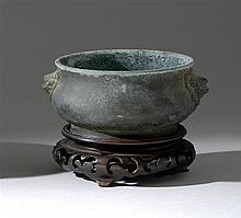 BRONZE CENSER In squat ovoid form with lion's-head handles. Six-character Xuande mark on base. Length 5.5