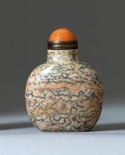 ROSE AND GRAY PUDDINGSTONE SNUFF BOTTLE In ovoid form. Height 2