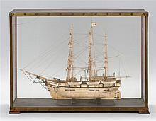 CASED BONE MODEL OF THE BARQUE WANDERER OF NEW BEDFORD Finely rigged, without sails. Four whaling boats suspended on davits. Flying...