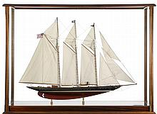 EXCEPTIONAL CASED MODEL OF THE SCHOONER YACHT ATLANTIC Model with planked decks, mahogany cabins, skylights, and four detailed lifeb...