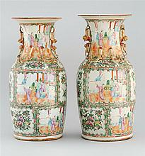 TWO NEAR-MATCHING CHINESE EXPORT ROSE MEDALLION PORCELAIN VASES Applied dragon and dog-form mounts at neck. Heights 17