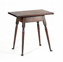 ANTIQUE AMERICAN TAVERN TABLE With breadboard top, turned splayed legs and duck feet. Height 24