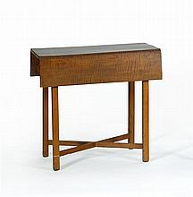 ANTIQUE AMERICAN DROP-LEAF TABLE In maple and tiger maple. Top with exceptional tiger maple graining. Block legs joined by a simple...