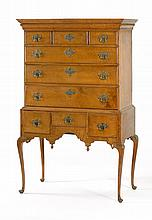 ANTIQUE AMERICAN QUEEN ANNE HIGHBOY In maple with curly maple drawer fronts. Upper case with hidden drawer in molding over four full...