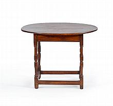 ANTIQUE AMERICAN TAVERN TABLE In maple with oval top, turned legs and stretcher base. Height 25
