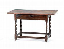 ANTIQUE AMERICAN ONE-DRAWER TAVERN TABLE In pine and maple with breadboard top, turned legs and stretcher base. Height 26