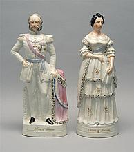 TWO LARGE STAFFORDSHIRE FIGURES In the form of the King and Queen of Prussia. Heights 16.75