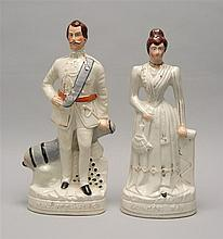 TWO LARGE STAFFORDSHIRE FIGURES In the forms of the Duke of Clarence and Princess May. Heights 16