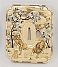 SUPERB SHIBAYAMA-INLAID IVORY TSUBA In hokei form with decoration of figures in a cherry tree landscape. Length 4¼