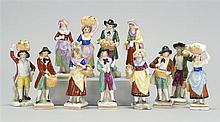 TWELVE ASSORTED CHELSEA PORCELAIN FIGURES Male and female merchants. Each with gilt anchor mark on back. Heights from 3½