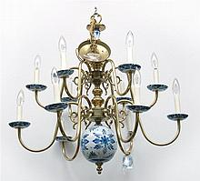 DELFT-STYLE TWELVE-ARM CHANDELIER Central column in brass with two blue and white pottery balls. Arms with small blue and white pott...