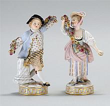 PAIR OF MEISSEN PORCELAIN FIGURES A young man and woman holding floral garlands. Crossed swords mark on base. Height 6½