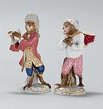 TWO MEISSEN PORCELAIN FIGURES In the form of monkeys, one holding a flute and the other a pair of drums. Crossed swords mark on base...