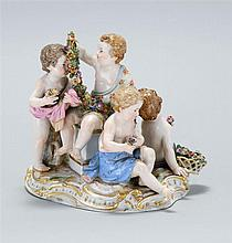 MEISSEN PORCELAIN FIGURAL GROUP Four children surrounding a pedestal. Crossed swords mark on base. Height 6½