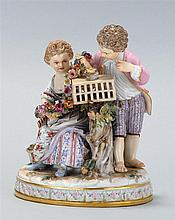 MEISSEN PORCELAIN FIGURAL GROUP Two children viewing a young bird atop a cage. The girl is holding a floral garland. Crossed swords...
