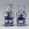 PAIR OF BLUE AND WHITE DELFT POTTERY TOBY PITCHERS In the form of seated men holding pitchers. Poses slightly different. Heights 9½