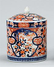 IMARI PORCELAIN COVERED JAR In cylindrical form with domed cover. Height 9¾
